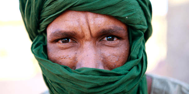"Portrait of a man inside the ""27 February"" Saharawi refugee camp near Tindouf, Algeria."